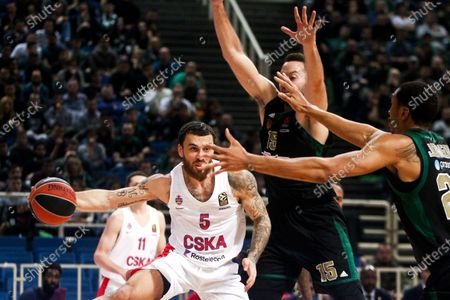Stock Picture of Panathinaikos' Ian Vougioukas (M) and Wesley Johnson (R) in action with CSKA's Mike James(L) during the Euroleague Basketball match between Panathinaikos and CSKA Moscow held at OAKA in Athens, Greece, 05 March 2020.