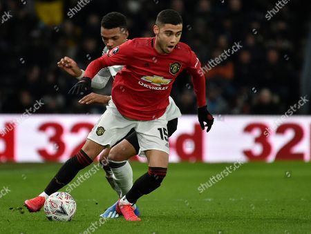 Manchester United's Andreas Pereira, front, duels for the ball with Derby's Morgan Whittaker during the FA Cup fifth round soccer match between Derby County and Manchester United at Pride Park in Derby, England