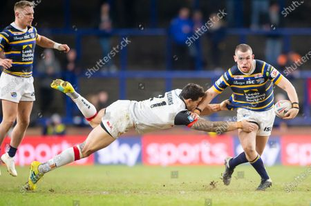 Stock Picture of Leeds's Cameron Smith evades the tackle of Toronto's Sonny Bill-WIlliams.