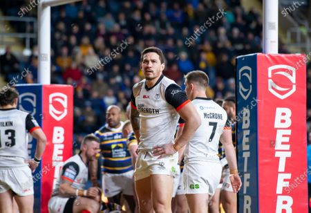 Toronto's Sonny Bill-Williams looks on at the replay screen after a Leeds try.