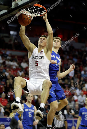 San Diego State's Yanni Wetzell dunks as Air Force's Keaton Van Soelen defends during the second half of a Mountain West Conference tournament NCAA college basketball game, in Las Vegas. San Diego State won 73-60