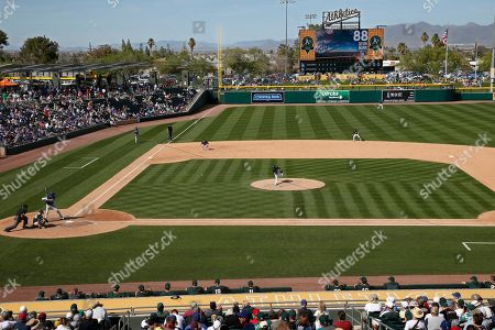 Oakland Athletics' Joakim Soria delivers a pitch to Los Angeles Dodgers Devin Mann in the sixth inning of a spring training baseball game, in Mesa, Ariz