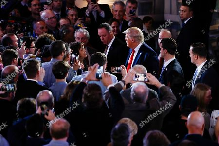 President Donald Trump meets with attendees after a FOX News Channel Town Hall, co-moderated by FNC's chief political anchor Bret Baier of Special Report and The Story anchor Martha MacCallum, in Scranton, Pa