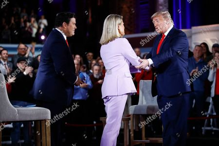 President Donald Trump greets FOX News Channel The Story anchor Martha MacCallum as co-moderator FNC's chief political anchor Bret Baier of Special Report looks on during a FOX News Channel Town Hall, in Scranton, Pa