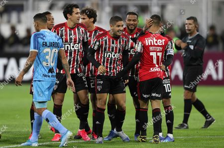 Alexandre Pato, center, of Brazil's Sao Paulo, celebrates with his teammates after scoring against Peru's Binacional during a Copa Libertadores soccer match at the Guillermo Briceno Stadium in Juliaca, Peru