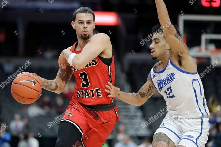 Illinois State's Ricky Torres (3) brings the ball down the court past Drake's Roman Penn (12) during the second half of an NCAA college basketball game in the first round of the Missouri Valley Conference men's tournament, in St. Louis