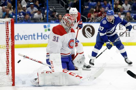 Montreal Canadiens goaltender Carey Price (31) makes a pad save on a shot by the Tampa Bay Lightning during the second period of an NHL hockey game, in Tampa, Fla