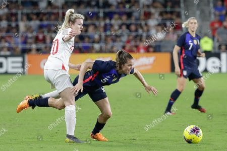 Kelley O'Hara, Lauren Hemp. United States' Kelley O'Hara (5) falls as she collides with England's Lauren Hemp, left, during the first half of a She Believes Cup soccer match, in Orlando, Fla