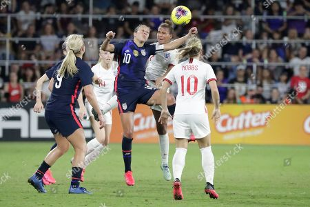 Carli Lloyd, Nakita Parris. United States' Carli Lloyd (10) goes up for a head against England's Nakita Parris, second from right, during the second half of a She Believes Cup soccer match, in Orlando, Fla