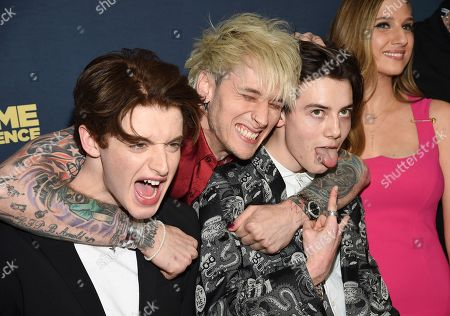 """Thomas Barbusca, Machine Gun Kelly, Griffin Gluck. Actors Thomas Barbusca, left, Machine Gun Kelly and Griffin Gluck pose together at the premiere of """"Big Time Adolescence"""" at Metrograph, in New York"""