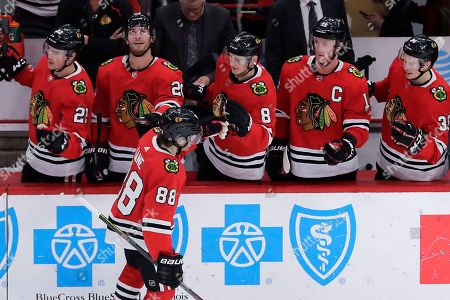 Chicago Blackhawks right wing Patrick Kane (88) celebrates with teammates after scoring a goal during the first period of an NHL hockey game against the Edmonton Oilers in Chicago