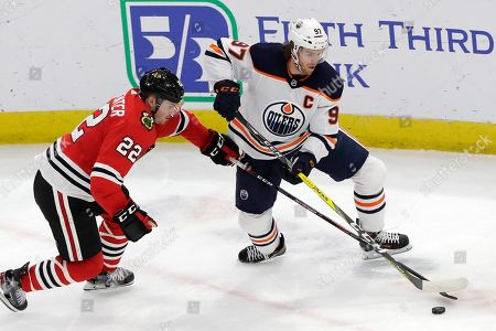 Connor McDavid, Ryan Carpenter. Edmonton Oilers center Connor McDavid, right, and Chicago Blackhawks center Ryan Carpenter battle for the puck during the first period of an NHL hockey game in Chicago