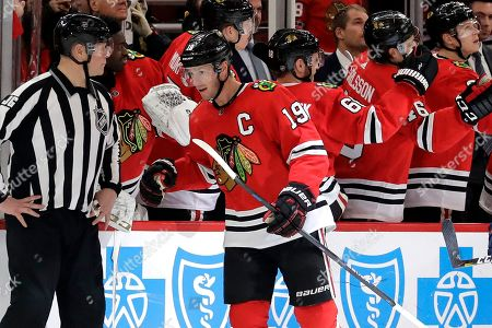 Chicago Blackhawks center Jonathan Toews (19) celebrates with teammates after scoring a goal against the Edmonton Oilers during the second period of an NHL hockey game in Chicago