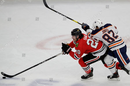 Brandon Saad, Caleb Jones. Chicago Blackhawks left wing Brandon Saad, left, controls the puck next to Edmonton Oilers defenseman Caleb Jones during the third period of an NHL hockey game in Chicago, . The Blackhawks won 4-3