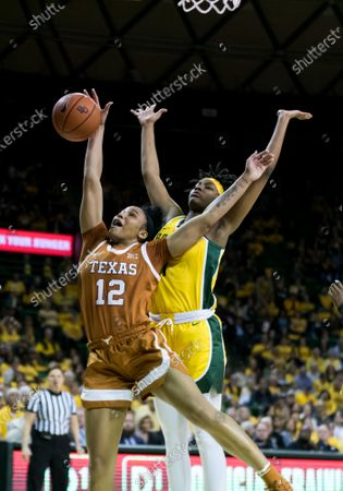 Baylor Lady Bears forward NaLyssa Smith (1) and Texas Longhorns guard Jada Underwood (12) fight for a rebound during the 2nd half of the NCAA Women's Basketball game between Texas Longhorns and the Baylor Lady Bears at The Ferrell Center in Waco, Texas