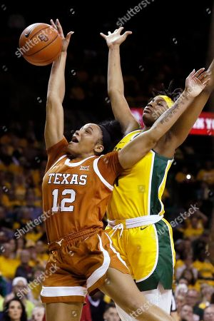 Stock Picture of Texas guard Jada Underwood, left, jumps in front of Baylor forward NaLyssa Smith for a rebound during the second half of an NCAA college basketball game, in Waco, Texas. Baylor won, 69-53