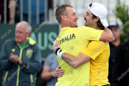 Lleyton Hewitt (C) and Jordan Thompson (R) of Australia celebrate winning against Thiago Monteiro of Brazil in the Davis Cup Qualifier between Australia and Brazil, at the Memorial Drive Tennis Centre in Adelaide, Australia, 06 March 2020.