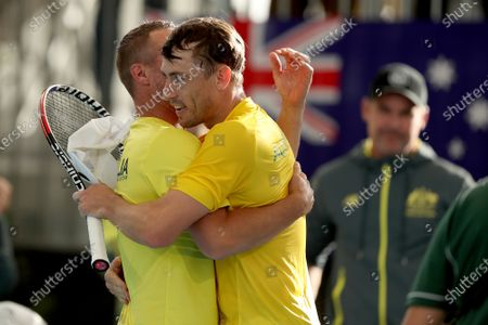 Australia coach Lleyton Hewitt (L) celebrates John Millman's win over Thiago Seyboth Wild of Brazil in the Davis Cup Qualifier between Australia and Brazil, at the Memorial Drive Tennis Centre in Adelaide, Australia, 06 March 2020.