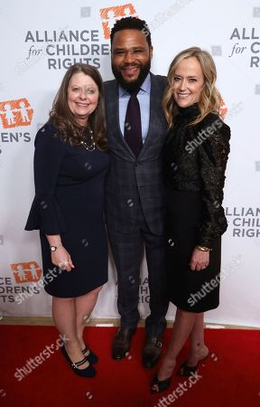 Jennifer L. Braun, Anthony Anderson, Karey Burke. Jennifer L. Braun, from left, Anthony Anderson and Karey Burke arrive at The Alliance for Children's Rights 28th Annual Dinner at The Beverly Hilton, in Beverly Hills, Calif
