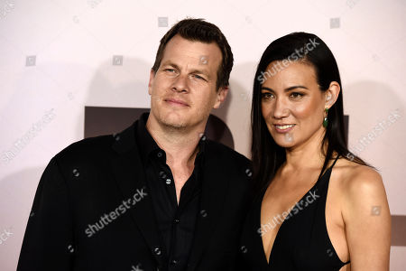 """Stock Picture of Jonathan Nolan, Lisa Joy. Jonathan Nolan, the co-creator/executive producer/director of the HBO series """"Westworld,"""" poses with his wife Lisa Joy at the Season 3 premiere of the show at the TCL Chinese Theatre, in Los Angeles"""