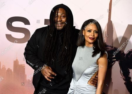 """Marshawn Lynch, Thandiwe Newton. NFL football running back Marshawn Lynch, left, a cast member in the HBO series """"Westworld,"""" poses with cast member Thandiwe Newton at the Season 3 premiere of the show at the TCL Chinese Theatre, in Los Angeles"""