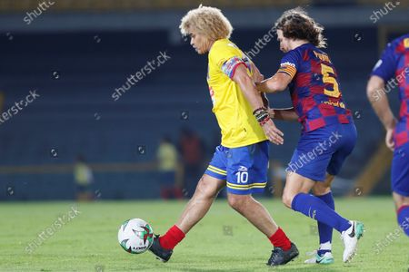 Carlos 'El Pibe' Valderrama (L) of Colombia in action against Carles Puyol (R) of Barcelona during a friendly soccer match between Legends of Colombia and Legends of FC Barcelona, at El Campin Stadium in Bogota, Colombia, 05 March 2020.