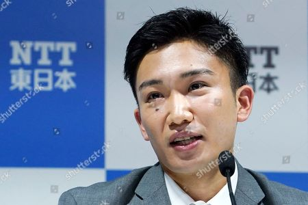 Japanese badminton player Kento Momota speaks a press conference, in Tokyo. Badminton men's singles world champion and world number one Momota was injured at a traffic accident In January this year in Malaysia