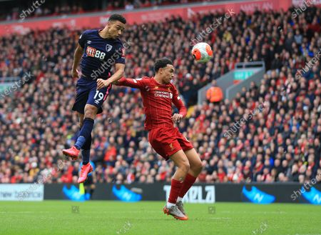 Stock Picture of 7th March 2020; Anfield, Liverpool, Merseyside, England; English Premier League Football, Liverpool versus AFC Bournemouth; Junior Stanislas of Bournemouth out jumps Joe Gomez of Liverpool to head the ball at goal