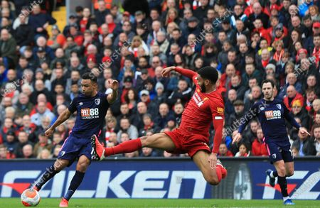 Stock Image of 7th March 2020; Anfield, Liverpool, Merseyside, England; English Premier League Football, Liverpool versus AFC Bournemouth; Junior Stanislas of Bournemouth shoots at goal as Joe Gomez of Liverpool stretches to block