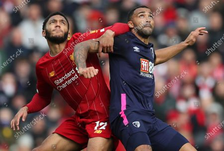 7th March 2020; Anfield, Liverpool, Merseyside, England; English Premier League Football, Liverpool versus AFC Bournemouth; Joe Gomez of Liverpool and Junior Stanislas of Bournemouth compete for the ball