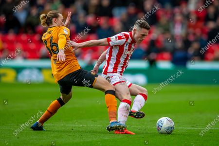 7th March 2020; Bet365 Stadium, Stoke, Staffordshire, England; English Championship Football, Stoke City versus Hull City; Jackson Irvine of Hull City puts Jordan Thompson of Stoke City under pressure