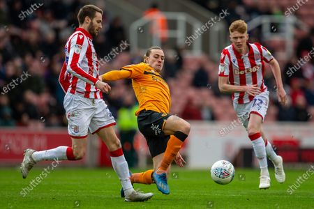7th March 2020; Bet365 Stadium, Stoke, Staffordshire, England; English Championship Football, Stoke City versus Hull City; Jackson Irvine of Hull City lunge for the ball in front of Nick Powell of Stoke City