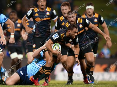 Aaron Cruden of the Chiefs is tackled  during a round six Super Rugby match between the New South Wales Waratahs of Australia and the Waikato Chiefs of New Zealand at WIN Stadium in Wollongong, New South Wales, Australia, 06 March 2020.