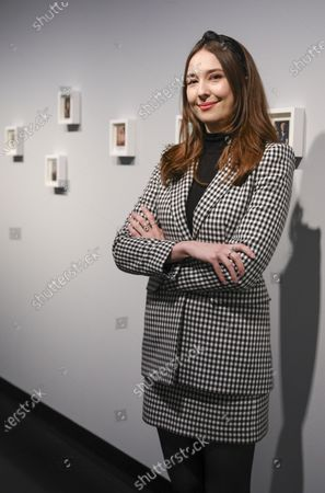 Curator of the McCarthney archive Sarah Brown poses next to Polaroids by Linda McCartney, part of the exhibition 'Linda McCartney-The Polaroid Diaries' at the C/O gallery in Berlin, Germany, 06 March 2020. The exhibition containes around 250 polaroids made by Linda McCartney, some date back as far as the early 70's, they provide an intimate look in to her life and inviornment, including visuals depicting The Beatles member and her Husband at the time Paul McCarthney. The exhibition will be on display 07 March to 06 June 2020 at the C/O gallery in Berlin.
