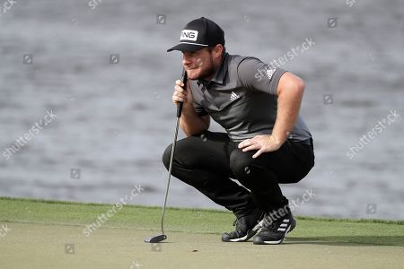 Tyrell Hatton, of England, lines up a putt on the sixth green during the second round of the Arnold Palmer Invitational golf tournament, in Orlando, Fla