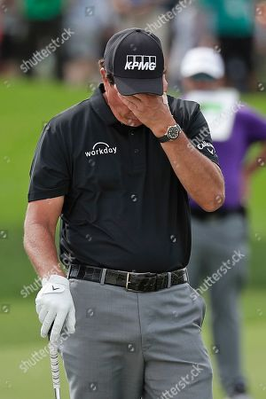 Stock Picture of Phil Mickelson reacts to his shot on the first fairway during the second round of the Arnold Palmer Invitational golf tournament, in Orlando, Fla