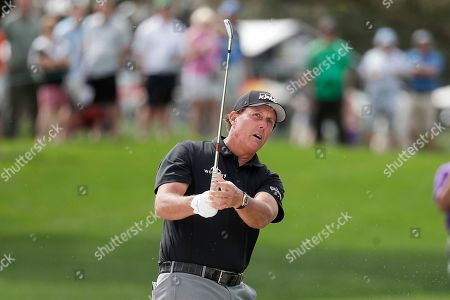 Phil Mickelson hits a shot on the first fairway during the second round of the Arnold Palmer Invitational golf tournament, in Orlando, Fla