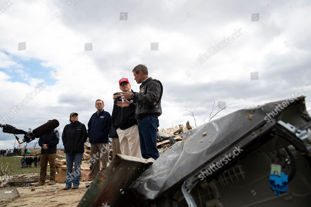 Stock Photo of Donald Trump, Maria Lee, Randy Porter, Ricky Shelton, Bill Lee, Mike Herrick. President Donald Trump, center, accompanied by from left, Mike Herrick, with Putnam County Rescue Squad, Tennessee first lady Maria Lee, Putnam County Mayor Randy Porter, Cookeville Mayor Ricky Shelton, Trump, and Gov. Bill Lee, R-Tenn., as they tour damage from a recent tornado, in Cookeville, Tenn