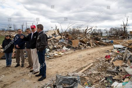 Stock Image of Donald Trump, Maria Lee, Randy Porter, Ricky Shelton, Bill Lee. President Donald Trump, center, accompanied by from left, Tennessee first lady Maria Lee, Putnam County Mayor Randy Porter, Cookeville Mayor Ricky Shelton, Trump, and Gov. Bill Lee, R-Tenn., as they tour damage from a recent tornado, in Cookeville, Tenn