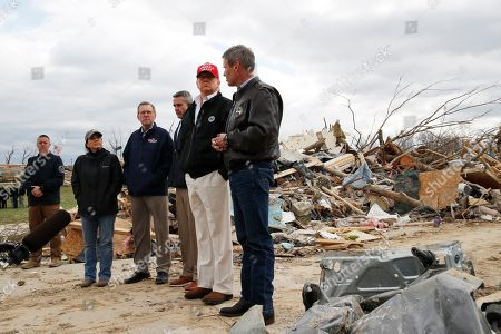 Stock Photo of President Donald Trump, accompanied by from left, Tennessee First Lady Maria Lee, Putnam County Mayor Randy Porter, Cookeville Mayor Ricky Shelton, Trump, and Gov. Bill Lee, R-Tenn., tour damage from a recent tornado, in Cookeville, Tenn. Far left is security personnel