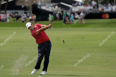 Patrick Reed hits a shot on the first fairway during the second round of the Arnold Palmer Invitational golf tournament, in Orlando, Fla