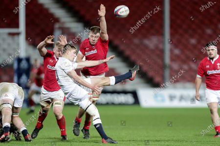 England U20 vs Wales U20. England's Jack Van Poortvliet clears the ball despite Jac Morgan and Ben Carter of Wales