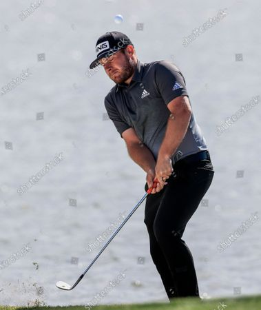 Tyrell Hatton of England chips onto the third green after hitting into the water and taking a drop during the second round of the Arnold Palmer Invitational golf tournament at Bay Hill Club & Lodge in Orlando, Florida, USA, 06 March 2020.