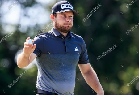 Tyrell Hatton of England holds up his ball after putting on the first hole during the second round of the Arnold Palmer Invitational golf tournament at Bay Hill Club & Lodge in Orlando, Florida, USA, 06 March 2020.