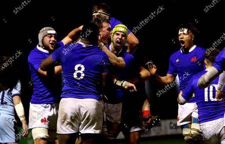 Scotland U20 vs France U20. France's Joshua Brennan celebrates scoring a try with his teammates