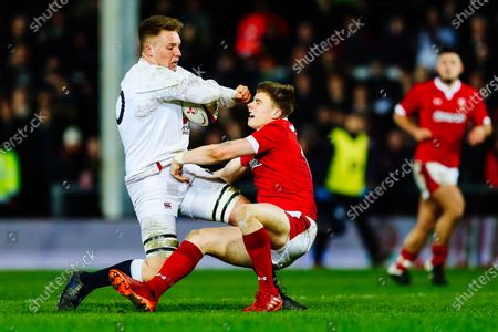 Jack Clement of England U20 is challenged by Jacob Beetham of Wales U20