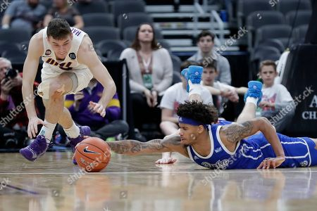 Stock Picture of Drake's Anthony Murphy, right, and Northern Iowa's Spencer Haldeman dive after a loose ball during the second half of an NCAA college basketball game in the quarterfinal round of the Missouri Valley Conference men's tournament, in St. Louis