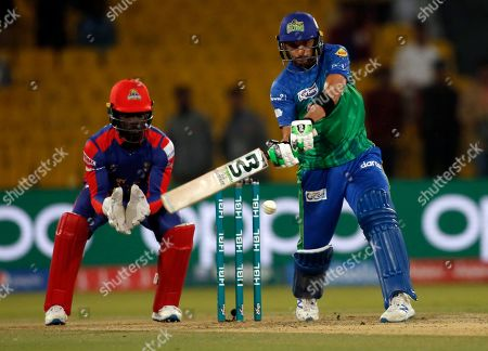 Shahid Afridi of Multan Sultans hits boundary, against Karachi Kings during a Pakistan Super League T20 match in Lahore, Pakistan. Shahid Afridi of Multan Sultans hits six as Chadwick Walton of Karachi Kings looks on during the Pakistan Super League T20 cricket match, in Lahore, Pakistan, . Multan Sultans stretched the points tally to nine as they snared a vital point from their game No. 6 in the Pakistan Super League against Karachi Kings was ended in no result due to rain