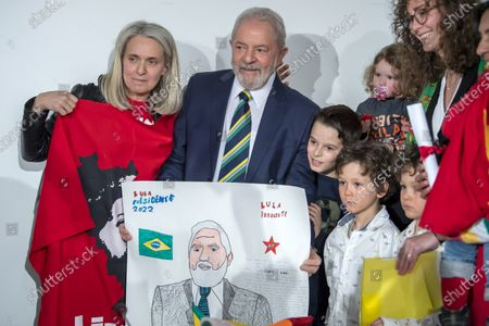 Former Brazilian President Luis Inacio Lula da Silva (C) poses with supporters before speaking about 'Dialogue about inequality with global unions and general public', during a press conference, at the Geneva press club, in Geneva, Switzerland, 06 March 2020.