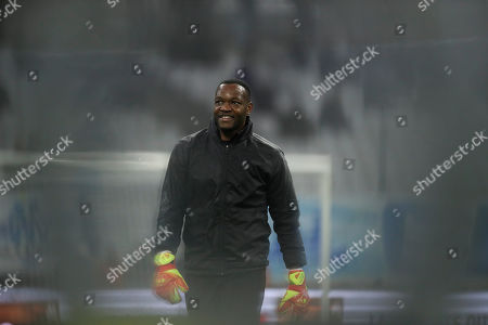 Marseille goalkeeper Steve Mandanda warms up prior the French League One soccer match between Marseille and Amiens at the Velodrome stadium in Marseille, southern France